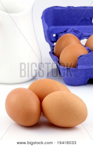 Milk Bottle And Brown Raw Eggs