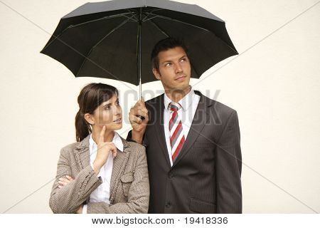 Businessteam of man and woman with umbrella