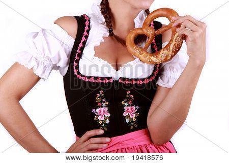 Bayerische Brezel mit Frau im dirndl