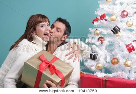 happy couple gift on christmas eve