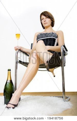 Sucess rich glamour girl sitting and drinking champagne
