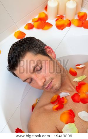 Guy relaxing peaceful in beautyfarm at home