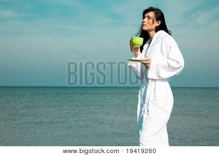 Young beauty feminine in white bath robe