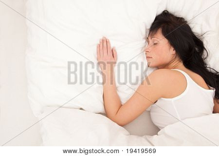 Sleeping woman alone at home
