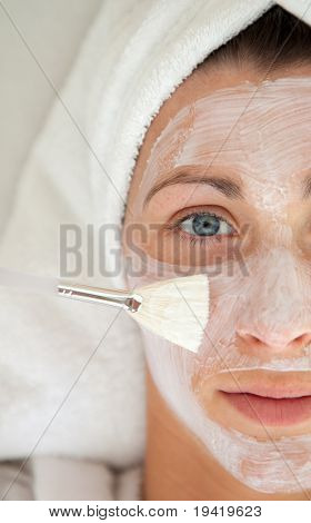 Pampered woman making anti-aging with face mask and care of the skin