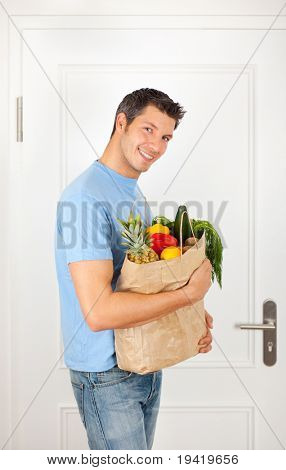 Attractive male bag holding buyer man