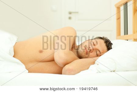 Beauty man sleeping in bedroom