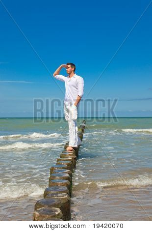 Successful Mans standing in ocean water relaxing and thinking or new business ideas having a interesting success vision