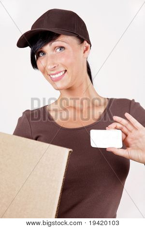 Friendly female postman having a packet for you holding packet and business card