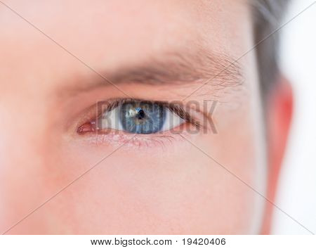 Male blue eye in close-up as symbol concept of successful business vision