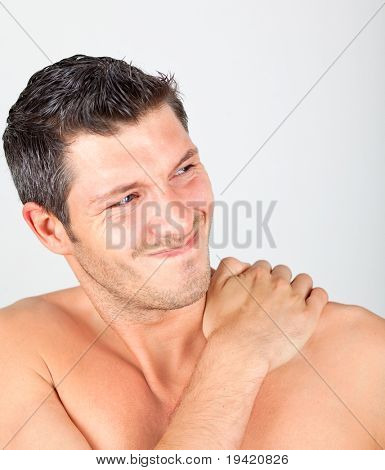 Painful physical masculine face expression