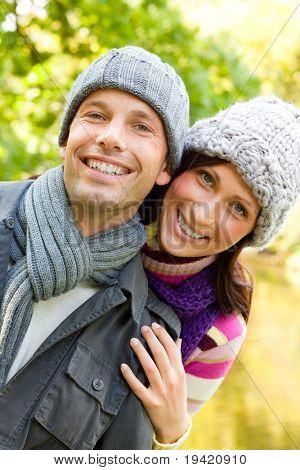 Happy forest heterosexual couple hugging