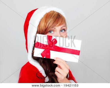 Santa woman with christmas wishing coupon bonus list