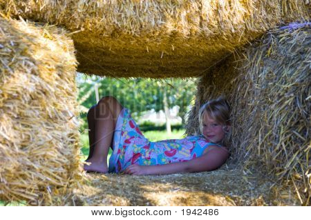 Cute Girl On Haybales