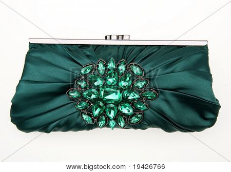 green woman's purse with stones