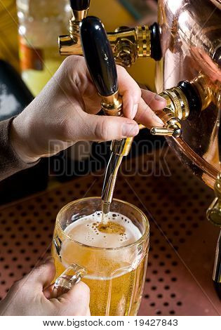 pouring a glass of beer