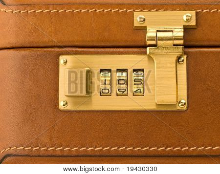 Business security. Business brief case with lock.