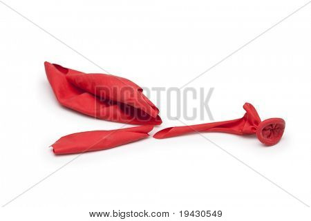 Popped red balloon isolated on white