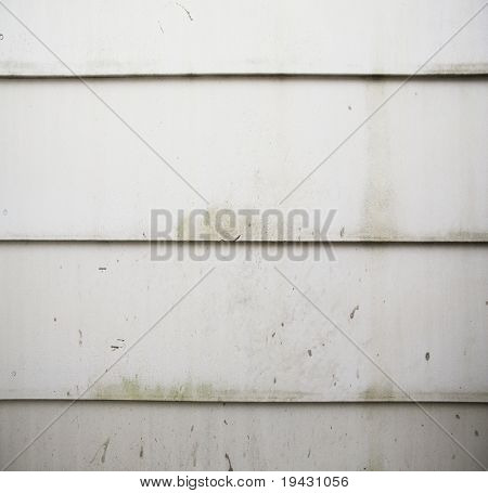 Grungy white house siding panel texture