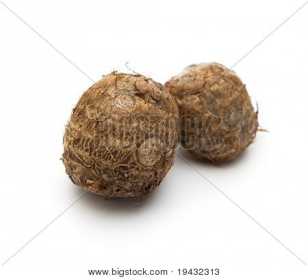Two satoimo potatos isolated on white.
