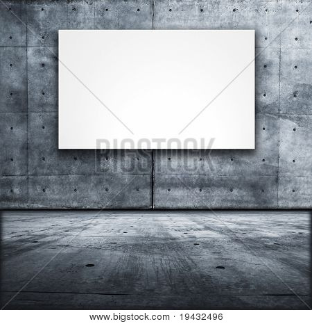 Blank white board in a grungy concrete room