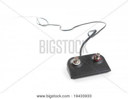foot activated switch with cable extending in to the distance. Isolated on white.