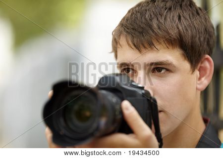 teen with camera