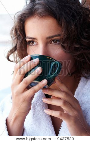beautiful girl drinking coffee in the morning