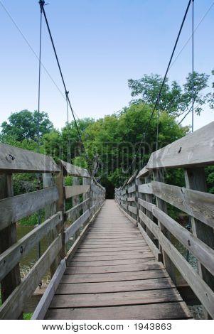 Handing Wood Bridge Over A River