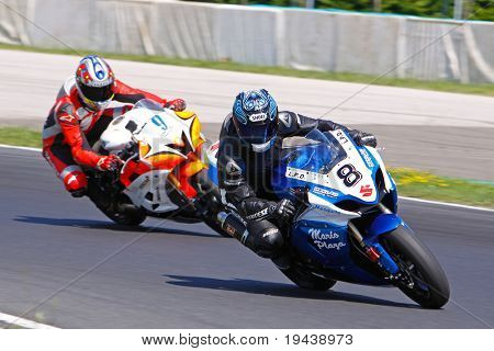 HUNGARORING, HUNGARY - JUNE 19: Two unidentified riders negotiate a corner during ROSBK event at Hungaroring Race Track on June 19,  2009 in Hungaroring, Hungary.