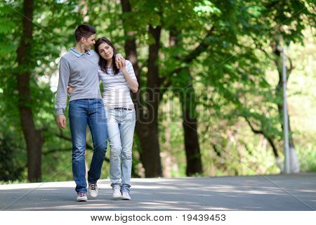 young couple taking a walk in the park