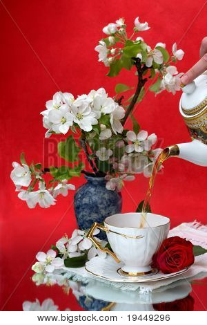 flavored tea in a white porcelain bowl and a  flower
