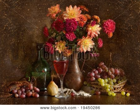 Still life with autumn flowers, grapes and wine