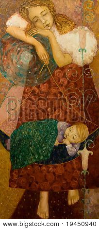 The girl shook the child in the cradle, painting on canvas