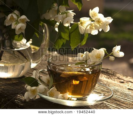 jasmine tea in a glass cup on the background of the old invoice board