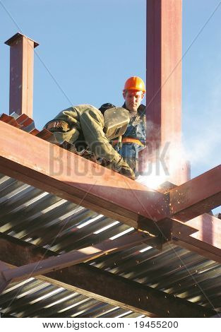 Two welders working on construction site