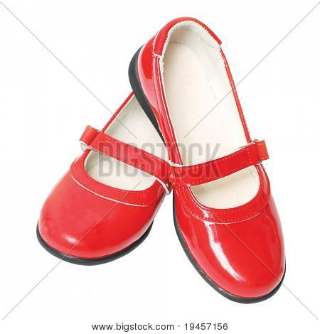 Red children's varnished shoes isolated on white background