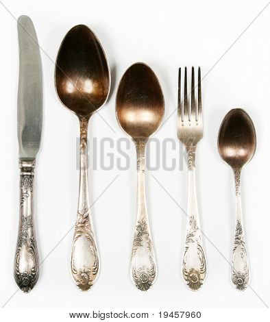 Vintage spoons, fork and knife isolated on white
