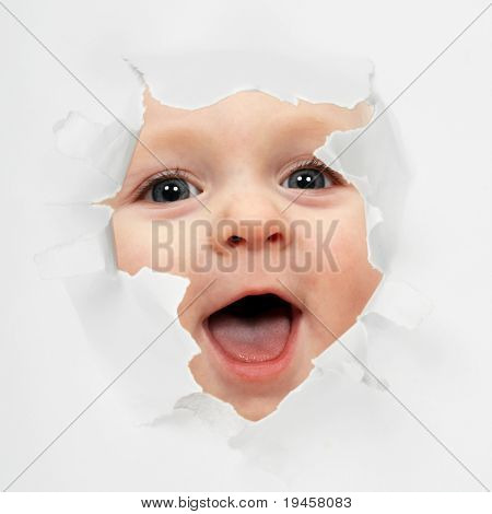 Baby looking through paper hole