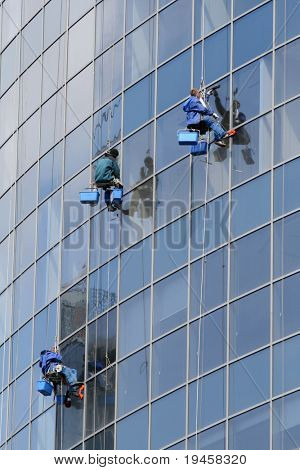 Window washers on a highrise office building in downtown