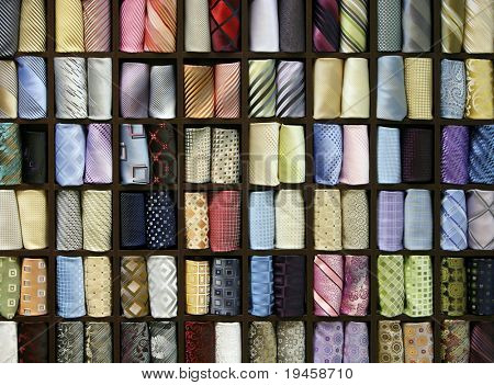 Multicolored male neck ties in a fashion store