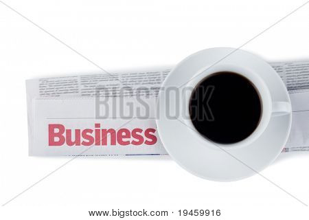 Folded newspaper and cup of coffee on a white background