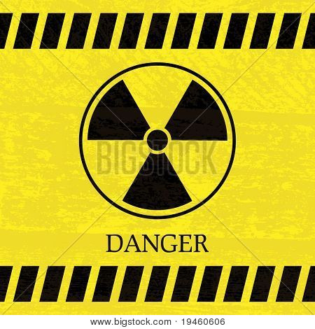 Nuclear danger warning sign on the splotchy background
