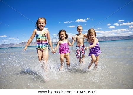 Ethnically diverse Children Playing at the Beach