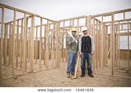 Building Contractors standing in an unfinished home