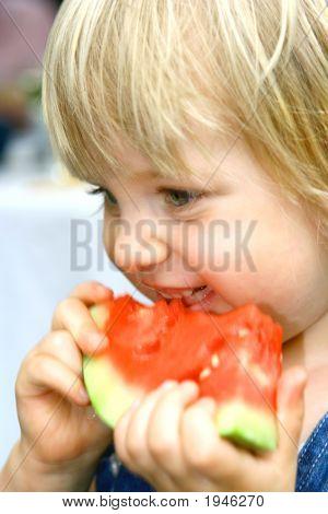 Toddler Girl Enjoying Watermelon