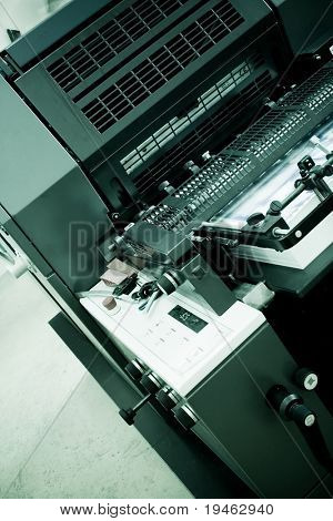 Closeup of an Offset Printing Machine in print shop
