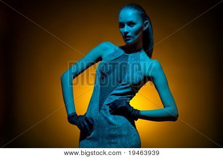 Glamorous image of fashion model in studio shot with colored gels for special effect