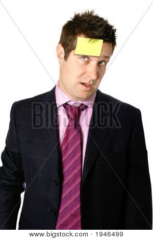 Businessman With Note Stuck On Forehead