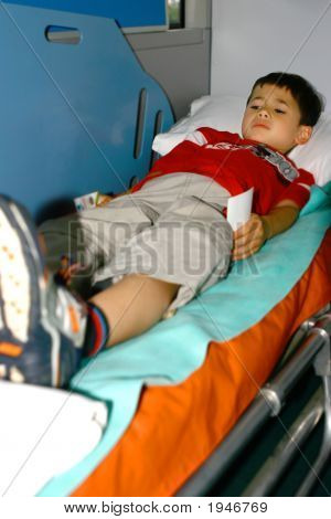 Injured Boy Being Tended In An Ambulance
